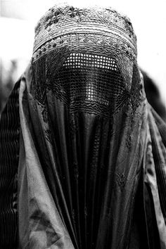 Burka. There is something oddly beautiful about these things. It sucks they have to wear this all the time though.