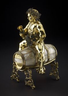 """Silver-gilt table-ornament in the shape of Bacchus siting on a wine barrel by Meinrad Bauch the Elder in Nuremberg, 1590-1602, British Museum. Acquired by Baron Anselm Rothschild before 1838. Similar, larger, silver wine vessel of 150 litres on wheels was described in the Kazanowski Palace in Warsaw, in Adam Jarzębski's """"Short Description of Warsaw"""" from 1643. Photo: © Trustees of the British Museum. #mannerism #artinpl #winevessel Bacchus, Baron, British Museum, Drinking Games, Sculpture, Statue, Wine, Commonwealth, Warsaw"""