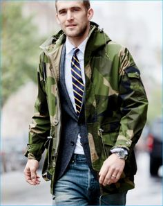 Will Chalker sports a camouflage hooded Arkair jacket from J.Crew with a blazer…