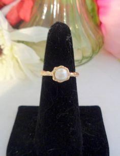 15% Coupon 4022017 Vintage Faux Pearl Ring on a Thin Gold Band. Adorable. Purchased at an Estate Sale. Get it while it is on sale.The Ring is a size 6. CCCsVintageJewelry.com