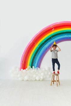 The ultimate rainbow Christmas gift guide for kids. DIY Rainbow Backdrop by Oh Happy Day.
