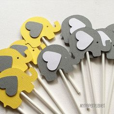 Yellow and grey elephant baby shower theme. A set of 8 elephant-shaped cupcake toppers, my original design, they are precision cut from textured