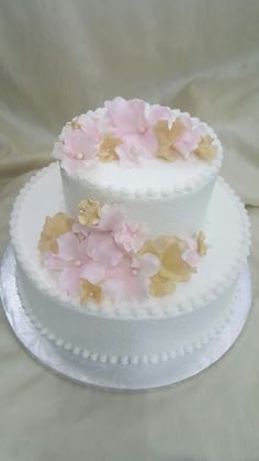 The cakebox Bahamas:  1-tier buttercream finished wedding cake with embossed sides and fondant flowers in gold and blush.