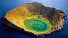 Volcanic crater off Santiago Island, Galápagos Islands, Ecuador (© Frans Lanting/Corbis) – 2015-09-29  [http://www.bing.com/search?q=Santiago+Island&form=hpcapt&filters=HpDate:%2220150929_0700%22]