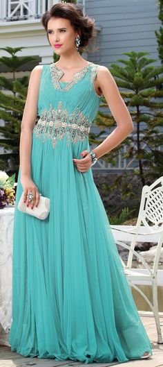 426823: Green color family stitched gown .