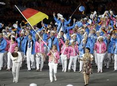 Dressed in pink and pale blue jackets, the 395 German athletes were led by hockey player Natascha Keller
