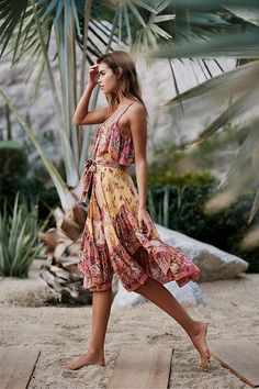 In a beautiful bohemian printed design, this midi dress features a flouncy overlay at the bust and a ruffled hem. #resortwear #ad #beachwear #vacation #dress #comfy #casual #hippy #hippie #boho #bohemian