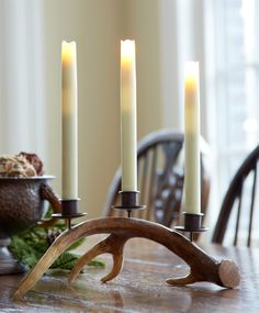 This beautiful antler candle holder holds 3 tapers.