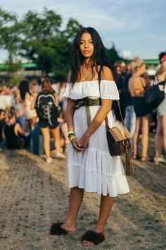 The Fire Looks From New York's Newest Music Fest #refinery29  http://www.refinery29.com/2016/07/117807/panorama-festival-street-style-2016#slide-10  Yes, those are some very fluffy slides you're seeing on the designer herself: Aurora James of Brother Vellies....