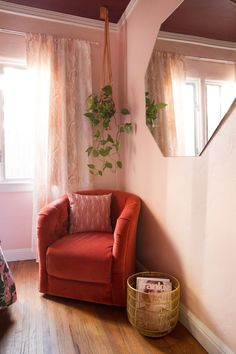 A blush bedroom design inspired by the 70's complete with velvet chair and art photography!
