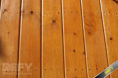 Pressure treated deck stained with DEFY Extreme Wood Stain cedar tone