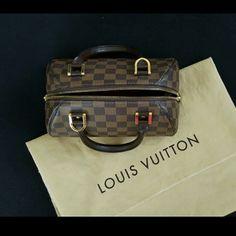 "Authentic Louis Vuitton: Damier Ribera Mini Measurements: 9""L x 5""W x 5.5""H Handle drop: 3.5"" Production year : 2005  Includes original dust bag  Interior is red with gold hardware Louis Vuitton Bags"