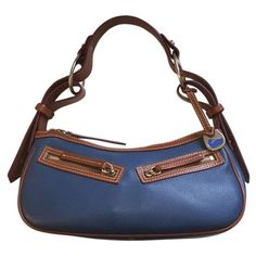 """Dooney  & Bourke Leather Hobo -- Gorgeous royal blue pebbled leather hobo with rich caramel leather trim. Excellent pre-owned condition with minimal wear.  -- Off-white detailed stitching  -- Shoulder drop 8.5""""  -- Gold tone hardware  -- Two exterior zippered pockets   -- Zippered closure  -- Fabric interior lining  -- One interior zippered pocket   -- One interior pouch pocket -- perfect for business cards/gum  -- One interior leather strap with hook -- perfect for attaching a key fob…"""