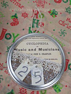 DIY rustic Christmas ornament or decor made from a ball or mason jar canning lid!  Looks like sheet music! #cutcraftcreate