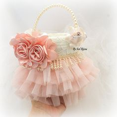 ***Ready to Ship ***This listing is for a tutu and pearl basket as shown or in ivory This adorable Sol Bijou flower girl basket is a soft and romantic combination of ivory and blush. The focal flower has been crafted with silk. The main body of the basket has been covered in ivory lace