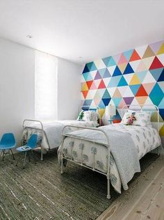 wallpaper design ideas colorful triangle statement wall in twin bedroom