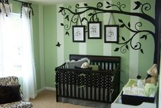 Tree/Branches with three photos hanging from branch. This is exactly what I want to do on one of the walls in the basement. Except have silhouettes of the kids instead of monograms.