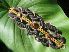 macrame bracelet with tiger eye stone in the center