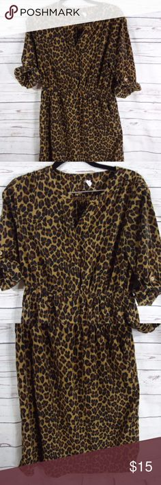 Old Navy Cheetah Print Dress Old Navy Cheetah Print Dress  With rolled up button sleeves and stretchy cinched waist Half Button Front Size medium Old Navy Dresses