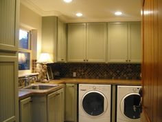full effect - consider a narrow divider - maybe with pull out cabinet-door-drawer - between machines?