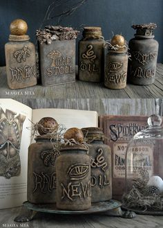 DIY:  Recycled Containers Get A Facelift For Halloween - this is an unbelievable transformation!!! The bottles are plastic vitamin bottles! The writing is from a glue gun & the bottles were painted with chalk paint.  magiamia.blogspot.com