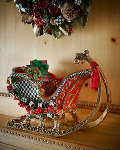 Santa\'s Sleigh by MacKenzie-Childs at Horchow. #HORCHOWHOLIDAY14