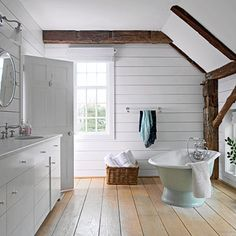 Vintage fixtures and exposed architectural details create a warm comfortable bathroom.