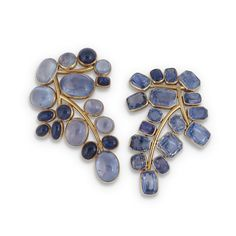 SUZANNE BELPERRON. A PAIR OF SAPPHIRE 'BRANCHE' BROOCHES Each designed as a stylised foliate branch, one set with oval- and circular-shaped cabochon sapphires, the other with variously-shaped facetted sapphires within rectangular- and octagonal-shaped collet settings. Each accompanied by a certificate of authenticity by Belperron stating that each was made in Paris in the period 1932 - 1955 and the facetted sapphire brooch has partial maker's marks for Societé Groené et Darde.