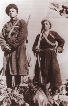Note that these two Cossack volunteers are standing on top of their horses!