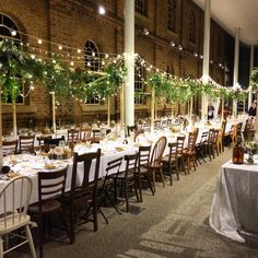 A gorgeous winter inspired wedding at Newcastle Museum. A forest and fairy light  canopy above the table of intricate hand picked items and mismatched timber chairs.