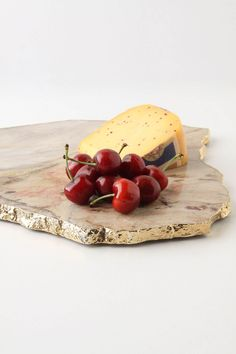 Elysian Platter - A hand polished slab of gold-dipped quartz or calcedonia will add a spectral, yet utterly earthly shimmer to any room or table spread.