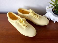 Yellow Canvas Sneakers / Never Worn Bright Pastel Yellow Old Vintage Canvas Kicks / Yellow Lace Up Flat Shoes / Yellow Sneakers size 8.5 by ShopRachaels on Etsy https://www.etsy.com/listing/494815860/yellow-canvas-sneakers-never-worn-bright