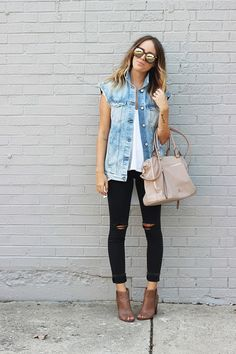 Ways to style a denim sleeveless vest in summer: with a white top and black bottoms for a sleek chic streetwear look!