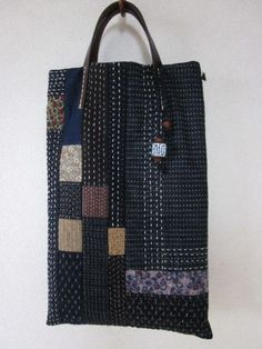 Sashiko- I'm currently loving this simple Japanese embroidery- orderly straight lines. I like the style of this bag PLUS the colors. Altogether it looks like Zen