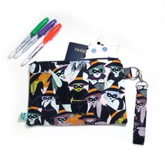 """Where all my witches at? Bag measures approx. 8.75"""" (width) x 6"""" (height). Cotton pouch is interfaced for strength and fully lined.Removable 4.75"""" strap (the loop is 9.5"""" total). Print placement will vary!Our products aremade in a cat friendly work space."""