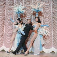 It's a hard life: Gene Kelly (centre) pictured with the elaborately dressed Folies Bergere showgirls in 1970 Showgirl Costume, Vegas Showgirl, Burlesque Costumes, Girl Costumes, Vintage Burlesque, Burlesque Show, Cabaret, Las Vegas Show Girls, Folies Bergeres