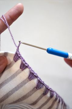 Tutorial on how to crochet an edging on flannel blankets.