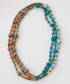 Layers of storm hued blues and earth tones form a color blocked accessory fit for your neck! This updated take on a classic Noonday piece is both versatile and fun.