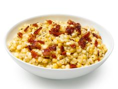 Grandma Moore's Creamed Corn : There are only two ingredients in this recipe: fresh corn and bacon. They come together beautifully as the starchy corn cooks up into a creamy mixture and the bacon on top adds crispy, salty bites of goodness.