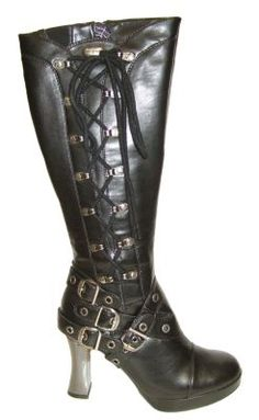 New Rock M5811 Black Vegan Leather Goth Box Heel Knee High boots with metal eyelets and black lacing up the side. The foot area features decorative buckle straps - two crossing over across the foot and two around the back of the ankle. The boots have a zip up the inside of the leg and a small elastic v-shaped panel in the top of the boot for extra stretch.