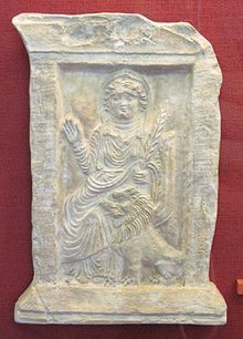 Bas-relief of Allāt from Palmyra, shown with a palm branch and a lion. Al-lāt is also explicitly attested from early Islamic records discussing the pre-Islamic period. According to the Book of Idols (Kitāb al-ʾAṣnām) by Hishām ibn al-Kalbi, the pre-Islamic Arabs believed Al-lāt resided in the Kaʿbah and also had an idol inside the sanctuary:  Her custody was in the hands of the Banū Attāb ibn Mālik of the Thaqīf, who had built an edifice over her. The Quraysh, as well as all the Arabs,