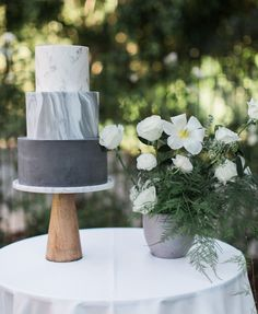 Three tier ombré wedding cake featuring marble, herringbone and chevron