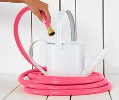 I wish I gardened...or had a house...or had any justification whatsoever to purchase a pink hose