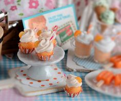 Orange juice and cream cheese combine for a tangy summertime treat! Included in this set are 4 orange creamsicle cupcakes that sit in festive party liners on a ceramic cake stand. Orange polka dot doily also included. All other items for decorative purposes only. Cupcakes attached to liners but not to stand. Not for children. Thanks for visiting my shop