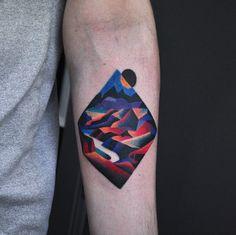 Surreal mountain range tattoo by David Cote