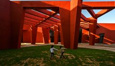Deep red walls and walkways shade the primary coloured interiors of this school in Rajasthan, India, by Sanjay Puri Architects. Red Beam, Desert Climate, India School, Indian Village, Best Architects, High Walls, Ground Floor Plan, Red Walls, School Pictures