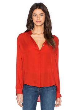 Break up the monotony and elevate your style by incorporating bold colors for the spring. This sleek and chic band collar top from L'Agence is the perfect way to start! http://www.hartlyfashions.com/product/bianca-blouse-harissa/