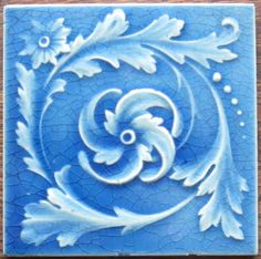 Swirling sky blue acanthus leaves from the Kensington Art Tile Company of Newport, KY. The tile is in excellent/very good condition with light edge wear as shown that does not detract from the gorgeous...