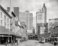 """New York circa 1908. """"Cortlandt Street,"""" with the new Singer Building rising in the distance."""