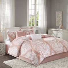A classic design gets a modern update with the Mowbray 7 Piece Comforter Set by Home Essence.  The coral comforter features a unique, white leaf design inside an oversized ogee pattern for an eye catching look.  Two matching shams and three decorative pillows add texture and design to this beautiful set.  Bedskirt included.